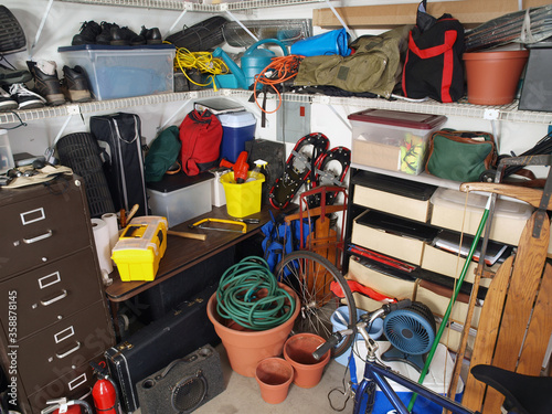 Big messy pile of stored items in typical suburban garage. #358878145