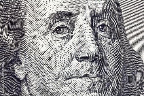 Cuadros en Lienzo Macro close up of Ben Franklin on the US $100 dollar bill.