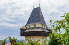 It's Clock Tower Of The Schlossberg (Castle Hill) Mountain In Graz. Part Of The UNESCO World Heritage In Graz, Austria