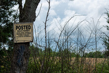 A Sign Warns Against Trespassing And Hunting On Private Land.