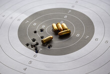Bullets On Paper Target For Shooting Practice