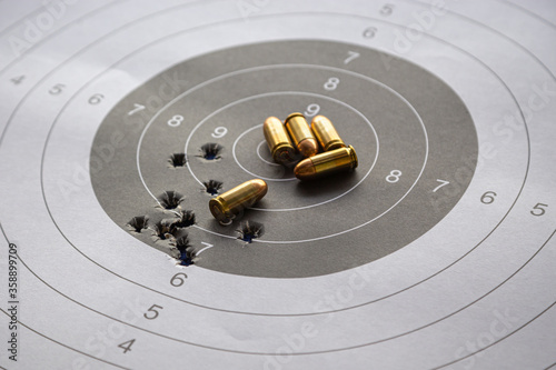 Obraz na plátně bullets on paper target for shooting practice
