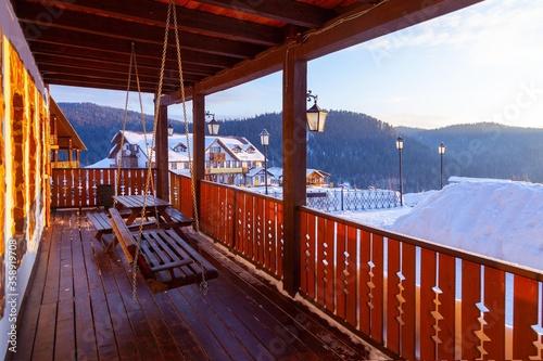 Fototapeta Ski resort, alpine village in winter