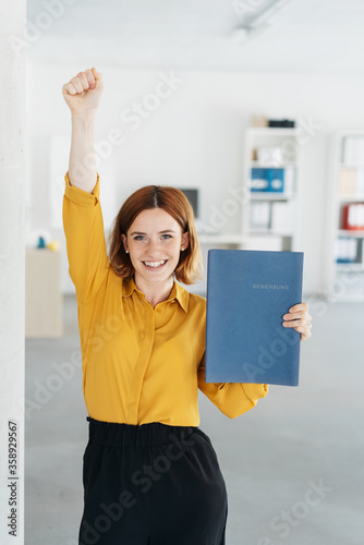 Obraz Excited young businesswoman cheering - fototapety do salonu