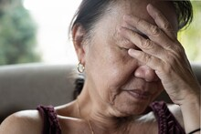 Old Senior Woman Worried And Stressed At Home.