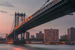 Manhattan Bridge and City Skyline at sunset