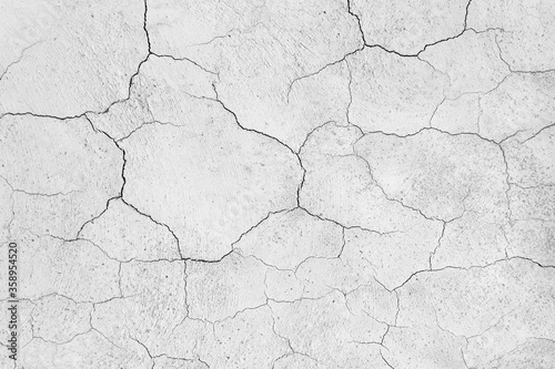 Fototapeta Old plaster wall crack surface for texture or backgrounds obraz