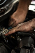 Auto mechanic working on spare parts for a car