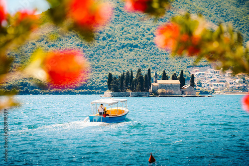 Fotografía Sightseeing boat with famous Sveti Dorde islet at the Bay of Kotor in summer, Pe