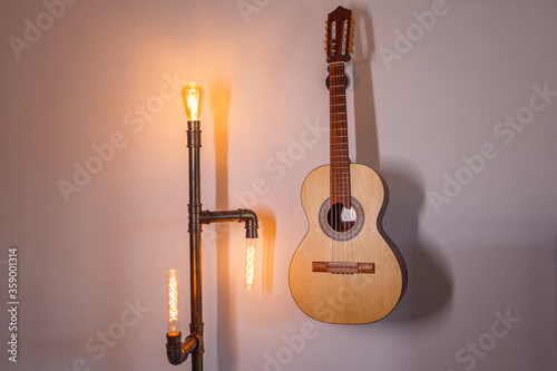 Photo Guitar hanging on the wall as decoration