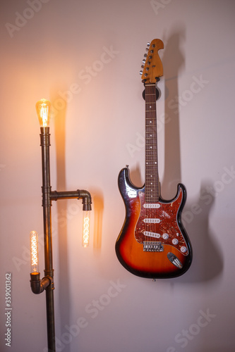 Guitar hanging on the wall Canvas Print