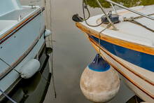 The Front End Of Two Pleasure Boats Moored In Thurne Dyke In The Norfolk Broads National Park