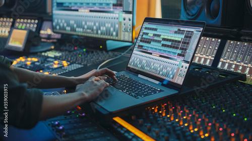 Slika na platnu Modern Music Record Studio Control Desk with Laptop Screen Showing User Interface of Digital Audio Workstation Software