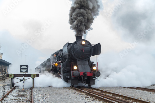 Fototapeta Old steam train - locomotive leaves the Nova Gorica railway station obraz na płótnie