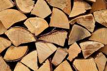 Hardwood Firewood Split Logs Stacked In A Pile, An End View.