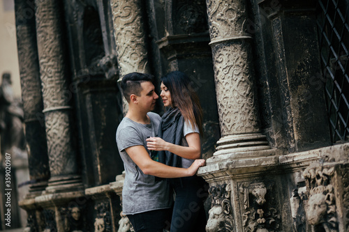 Fototapety, obrazy: couple posing on the streets of a European city in summer weather.