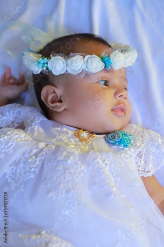 My Baby Daughter wearing her baptism crown and baptism gown on her day of Baptis Fototapeta
