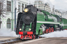 Steam Train Departs From Railway Station. Moscow. Russia.