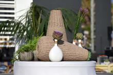 Artichoke Flower In A White Vase
