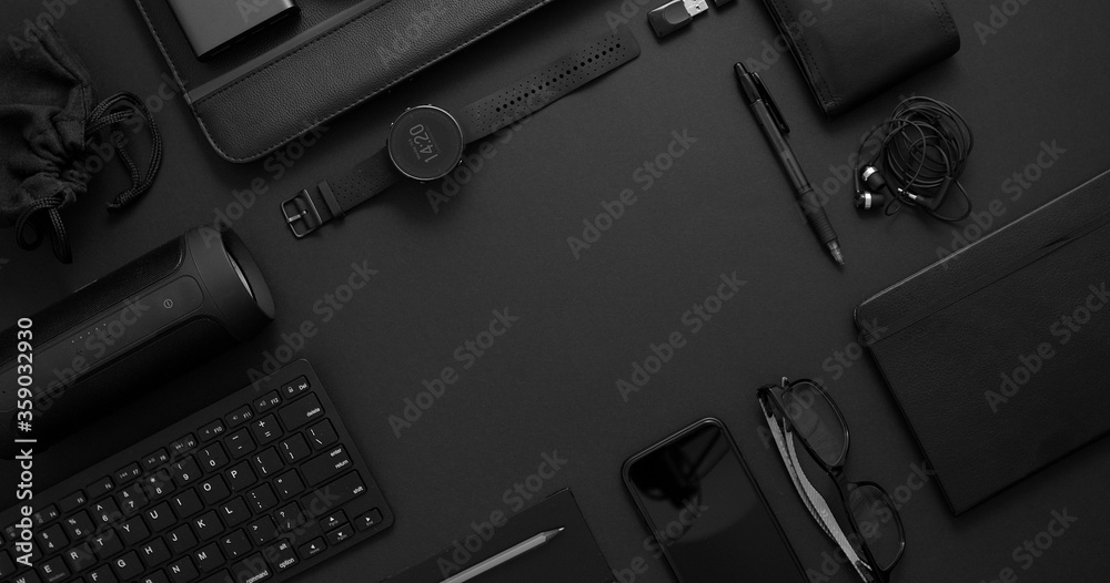 Fototapeta Business concept. Flat lay composition with various black gadgets on dark black surface