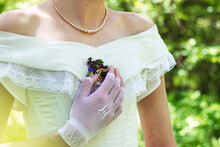 Bride In A Pearl Necklace With...