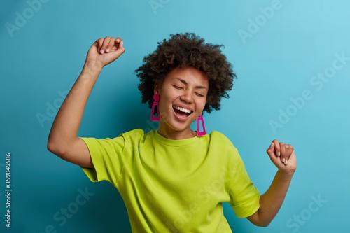 I am winner! Ecstatic overjoyed African American woman dances carefree, celebrat Wallpaper Mural