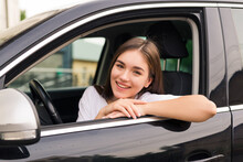 Relaxed Happy Woman On Summer Roadtrip Travel Vacation Leaning Out Car Window