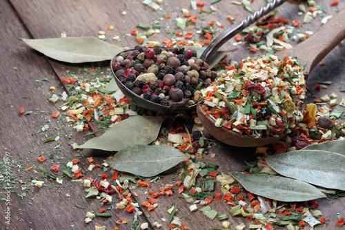 dry vegetables in a wooden spoon. vegetable seasoning Fotobehang