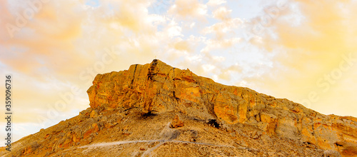 Edge of the rock with clody blue sky behind Canvas Print