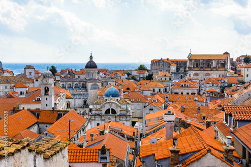 Fototapety, obrazy: It's View from the wall on the roof tops of the Old Town of Dubrovnik on a cloudy day, Croatia