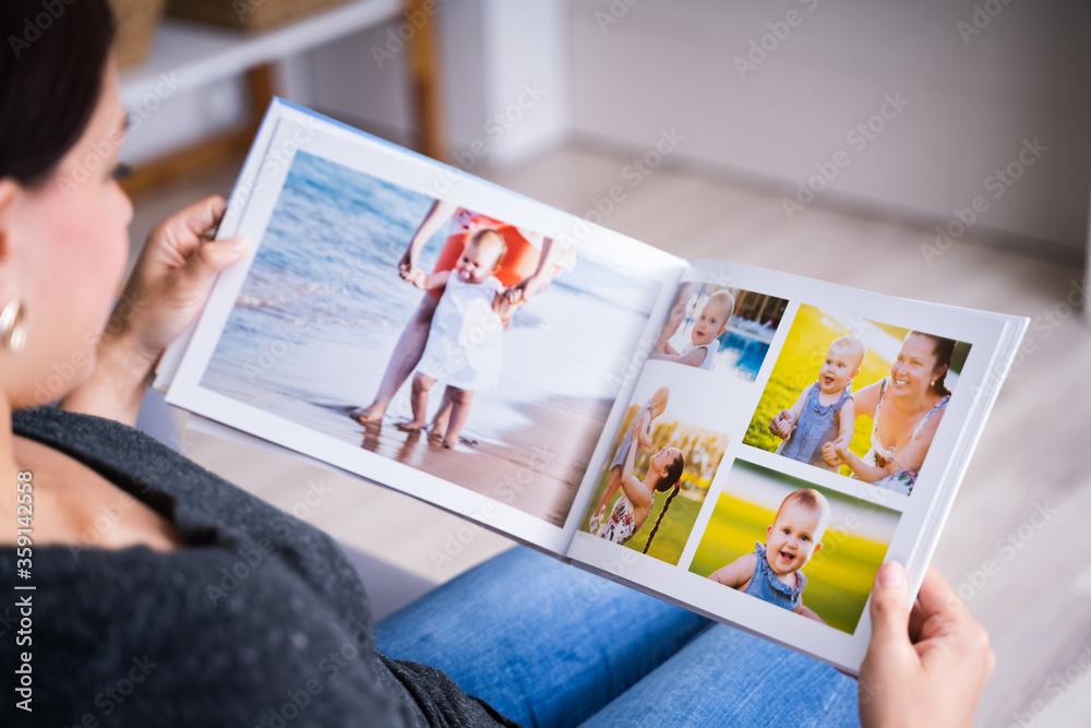 Fototapeta Woman Looking At Photo Album