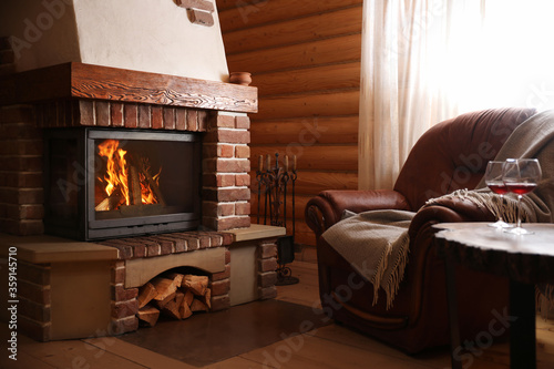 Modern cottage interior with stylish furniture and fireplace Fotobehang