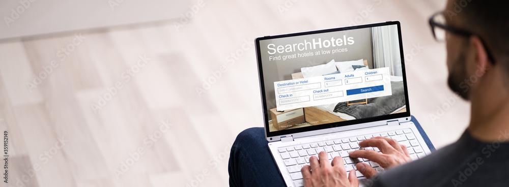 Fototapeta Man Booking Hotel On Website