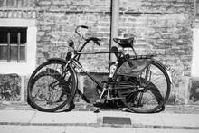 Old Bicycle On A Brick Wall Ba...
