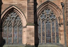 An External View Of The Leaded, Stained Glass Windows In A Church.