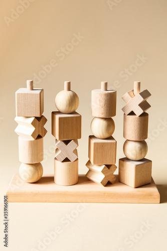 Obraz Children's wooden toys. Sequencing education Blocks, motor skills - fototapety do salonu