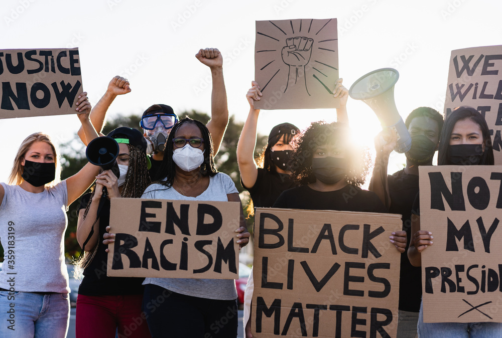 Fototapeta People from different culture and races protest on the street for equal rights - Demonstrators wearing face masks during black lives matter fight campaign - Focus on black woman face