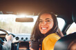 Travel, tourism -Beautiful woman with a couple of tea or coffee smiling while sitting on the seat in the car