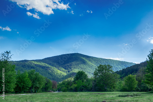 Green spring landscape view of a mountain meadow in Stara Planina mountain, Bulgaria, Balkans