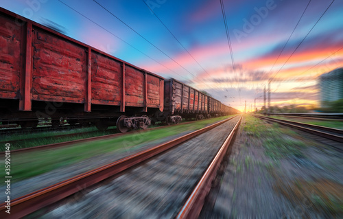 Fotografía Moving freight train at sunset