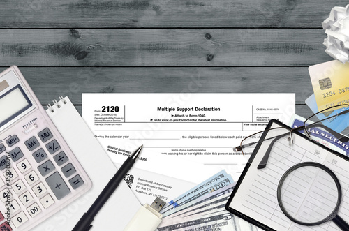 IRS form 2120 Multiple support declaration lies on flat lay office table and ready to fill Wallpaper Mural