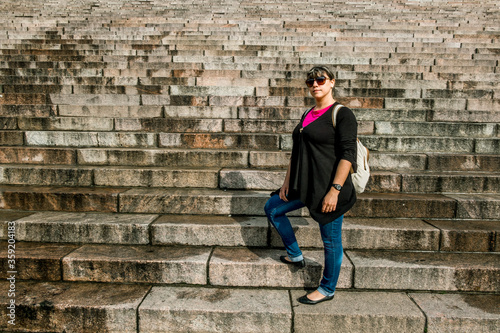 Girl posing standing on a granite staircase. #359204183