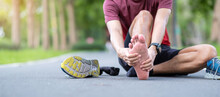 Young Adult Male With His Muscle Pain During Running. Runner Man Having Leg Ache Due To Plantar Fasciitis. Sports Injuries And Medical Concept