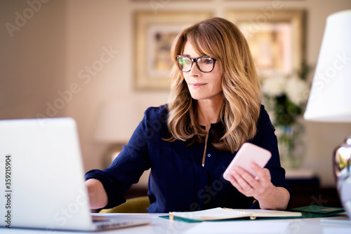 Fotografie, Obraz Businesswoman working from home
