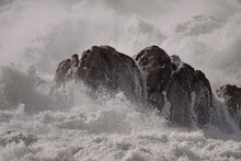 Sea Boulders In A Stormy Day