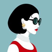 Elegant Woman Wearing Pearl Necklace