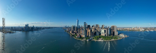 Aerial panorama of New York City skyline with both Jersey City and downtown Manh Wallpaper Mural