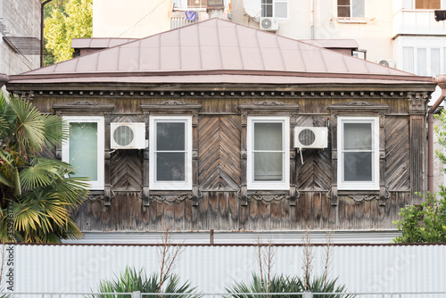 Very old wooden house with modern Windows and air conditioning Canvas Print