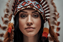 Close-up Portrait Of A Nude Female Wearing Feather Mayan Headdress, Aztec Conceptual Look