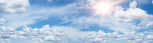 Hot Cloudy Summer Background Banner Panorama - Blue Sky With Clouds And Glowing Sun